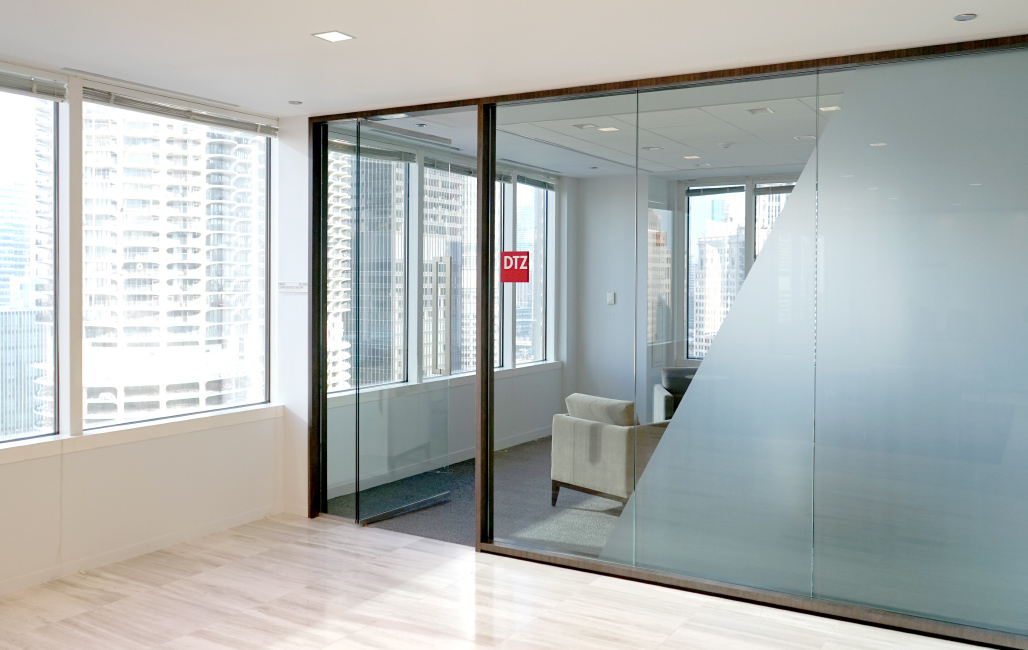 Environmental branding that incorporates privacy to executive conference room.